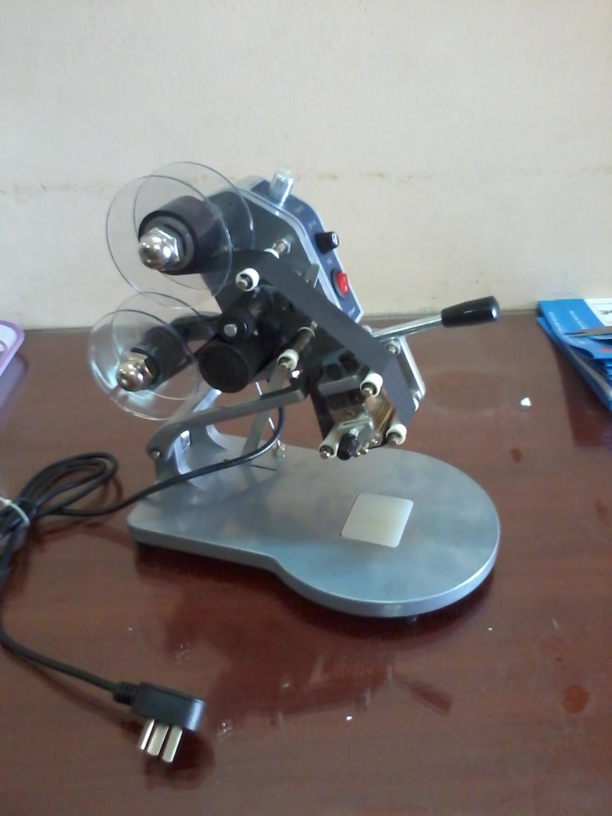 máy indate dập tay chuyên indate trên giấy, nilon, và mặt phẳng